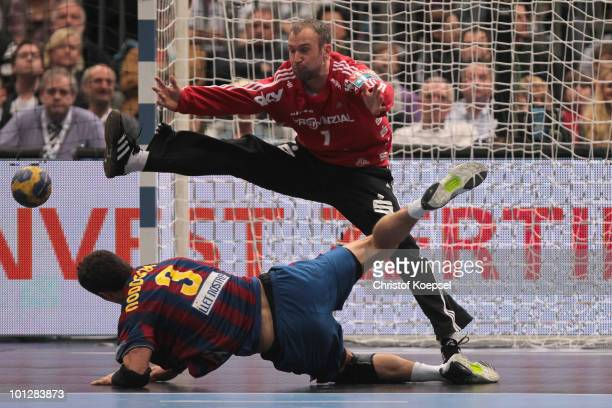 Thierry Omeyer of Kiel saves a shot of Jesper Brian Noeddesbo of Barcelona Borges during the handball final match between THW Kiel and FC Barcelona...