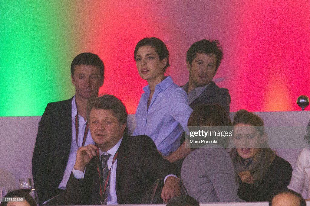 Thierry Rozier, Charlotte Casiraghi and Guillaume Canet attend the 'Gucci Paris Masters 2012' at Paris Nord Villepinte on December 2, 2012 in Paris, France.