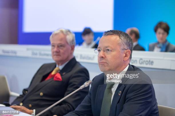Thierry Vanlancker chief executive officer of Akzo Nobel NV right looks on as he sits beside Antony Burgmans chairman of Akzo Nobel NV during a...
