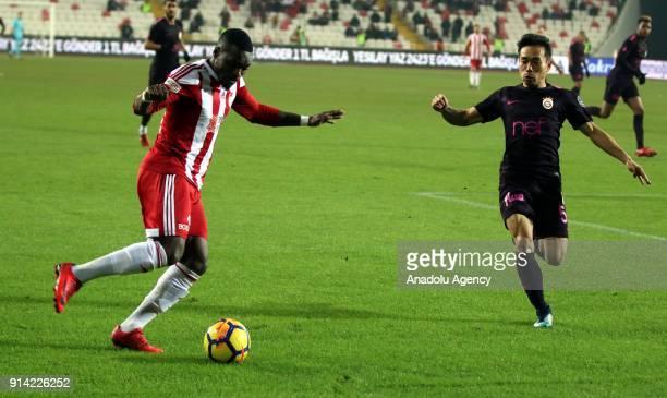 Thievy Bifouma of Demir Grup Sivasspor in action against Yuto Nagatomo of Galatasaray during a Turkish Super Lig week 20 soccer match between Demir...