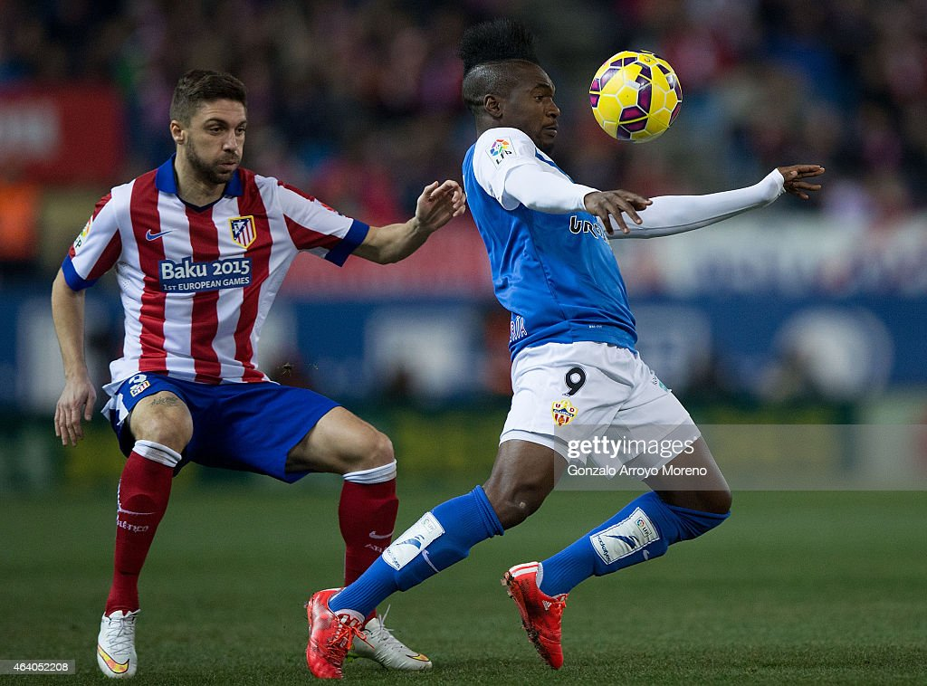 Thievy Guivane Bifouma Koulossa (R) of Almeria UD competes for the ball with Guilherme Madalena Siqueira (L) of Atletico de Madrid during the La Liga match between Club Atletico de Madrid and UD Almeria at Vicente Calderon Stadium on February 21, 2015 in Madrid, Spain.