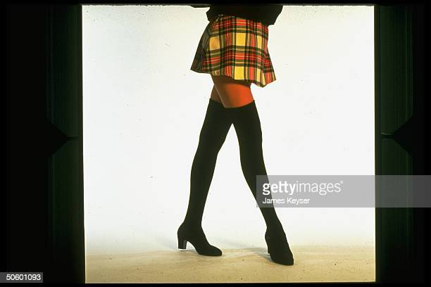 Thighhigh stockings worn w plaid miniskirt