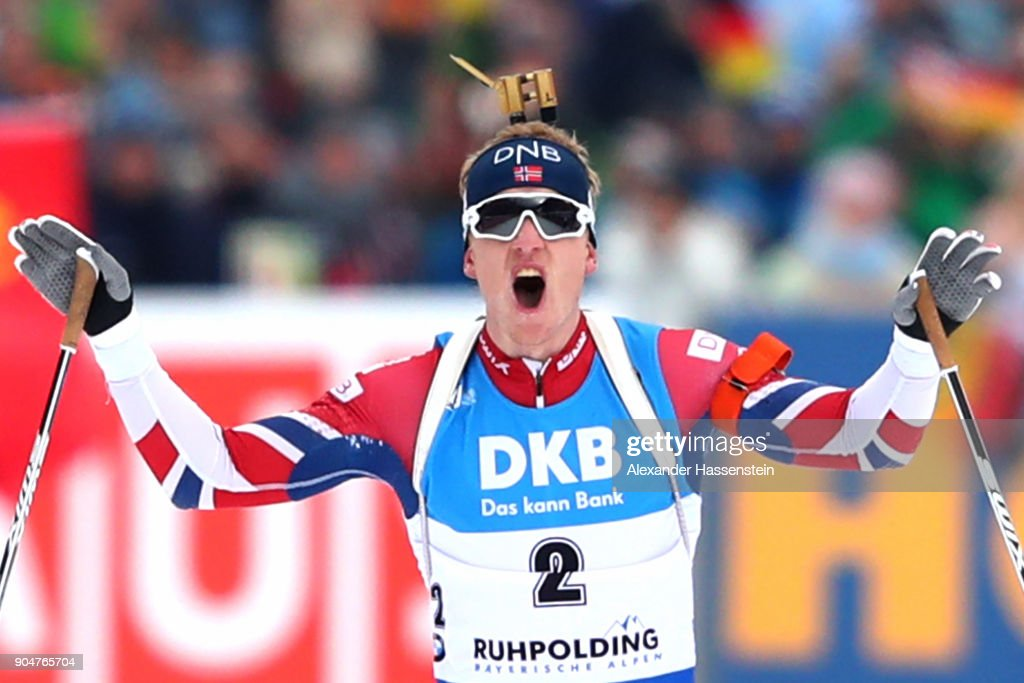 Thigngnes Joahnnes Boe of Norway celebrates winning the men's 15km mass start competition during the IBU Biathlon World Cup at Chiemgau Arena on January 14, 2018 in Ruhpolding, Germany.