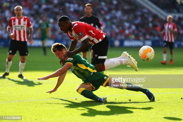 Thijmen Goppel of ADO Den Haag tackles Steven Bergwijn of PSV during the Eredivisie match between PSV and ADO Den Haag at Philips Stadion on April...