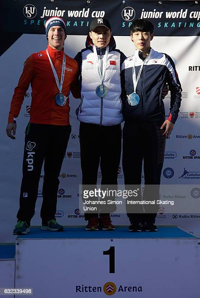 Thijs Govers of the Netherlands Yanan Jin of China and Seonghyeon Park of Korea pose during the medal ceremony after winning the first men's junior...