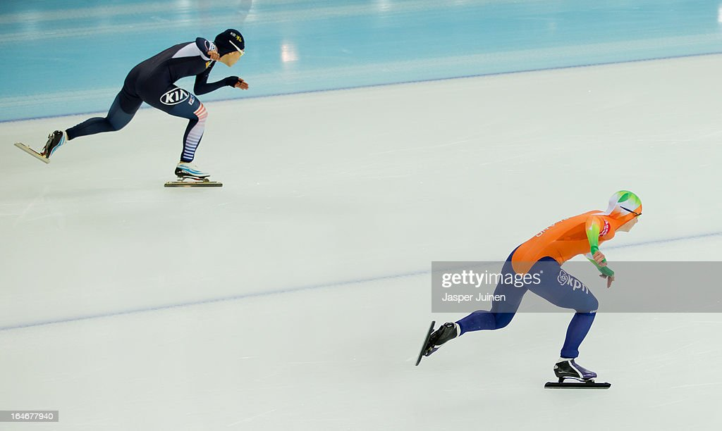 Thijsje Oenema (R) of the Netherlands competes against Sang-Hwa Lee of Korea during the 500m race on day four of the Essent ISU World Single Distances Speed Skating Championships at the Adler Arena Skating Center on March 24, 2013 in Sochi, Russia.