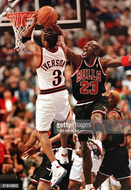 Thiladelphia 76ers Allen Iverson finds the Chicago Bulls Michael Jordan in the path to the basket 17 April in Philadelphia The Bulls won 8780...