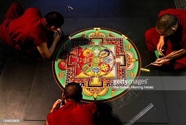Thiley Dorjee, Dhondup Tsering and Ngawang Tashi, Tibetan monks from Dakpa Khangsten Drepung Loseling Monastery in Southern India, make a Tibetan...
