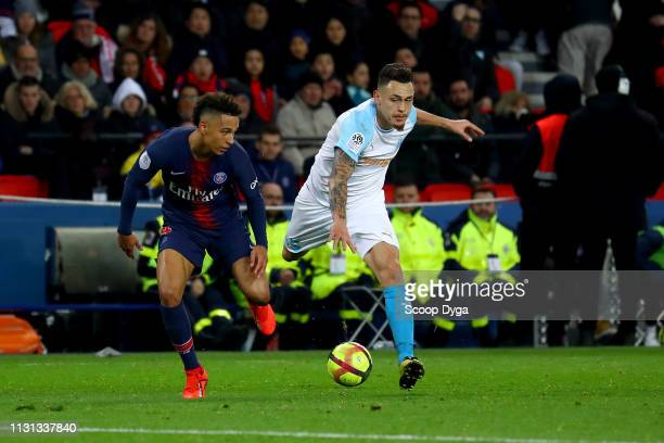 Thilo Keher of Paris Saint Germain and Lucas Ocampos of Olympique de Marseille during the Ligue 1 match between Paris Saint Germain and Marseille at...