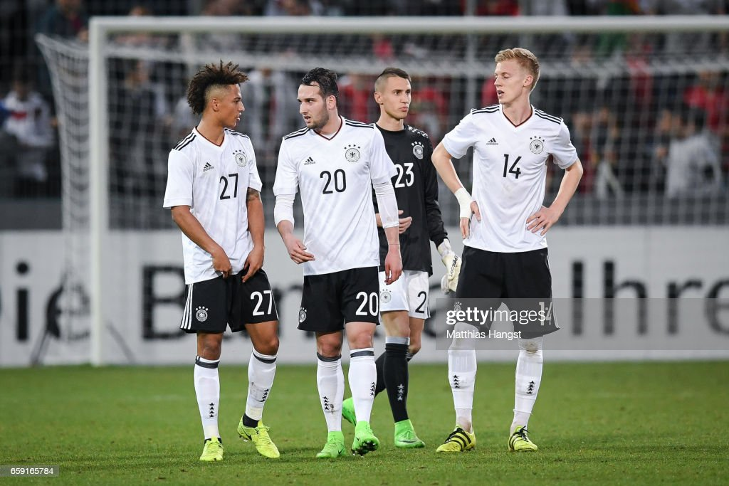 Thilo Kehrer (L-R), Levin Oeztunali, Odisseas Vlachodimos and Timo Baumgartl of Germany react after the U21 International Friendly match between Germany U21 and Portugal U21 at Gazi-Stadion auf der Waldau on March 28, 2017 in Stuttgart, Germany.
