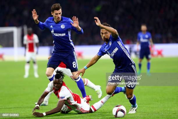 Thilo Kehrer of FC Schalke 04 tackles Bertrand Traoré of Ajax during the UEFA Europa League quarter final first leg match between Ajax Amsterdam and...