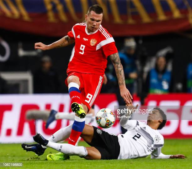 Thilo Kehrer of Germany and Anton Zabolotny of Russia vie for the ball during the international friendly match between Germany and Russia on November...