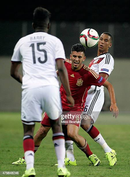 Thilo Kehrer of Germany competes with Dani Ceballos of Spain during the UEFA U19 Championship 2015 final tournament match between Spain and Germany...