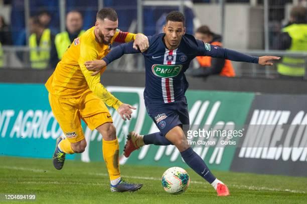 January 29: Thilo Kehrer of Paris Saint-Germain challenged by Damon Bansais of Pau during the Pau V Paris Saint-Germain, Coupe de France match at...