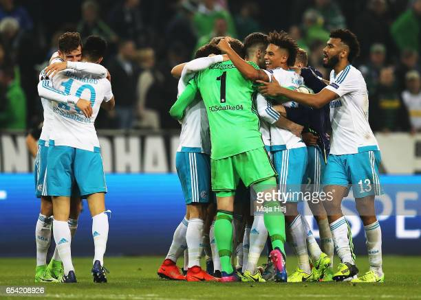 Thilo Kehrer of Schalke 04 celebrates with team mates after the UEFA Europa League Round of 16 second leg match between Borussia Moenchengladbach and...