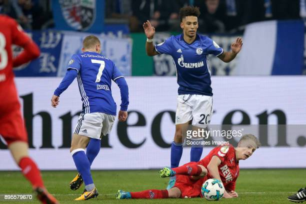 Thilo Kehrer of Schalke 04 Frederik Sorensen of FC Koln during the German DFB Pokal match between Schalke 04 v 1 FC Koln at the Veltins Arena on...