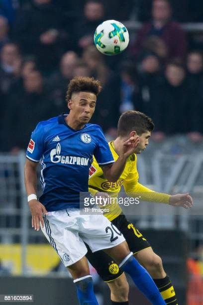 Thilo Kehrer of Schalke and Christian Pulisic of Dortmund battle for the ball during the Bundesliga match between Borussia Dortmund and FC Schalke 04...