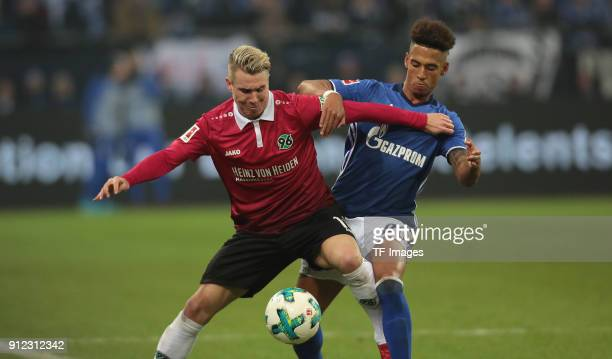 Thilo Kehrer of Schalke and Felix Klaus of Hannover battle for the ball during the Bundesliga match between FC Schalke 04 and Hannover 96 at...