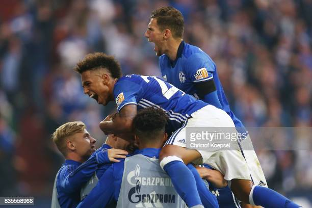 Thilo Kehrer of Schalke and Leon Goretzka of Schalke celebrate Yevhen Konoplynka of Schalke after he scores to make it 20 during the Bundesliga match...