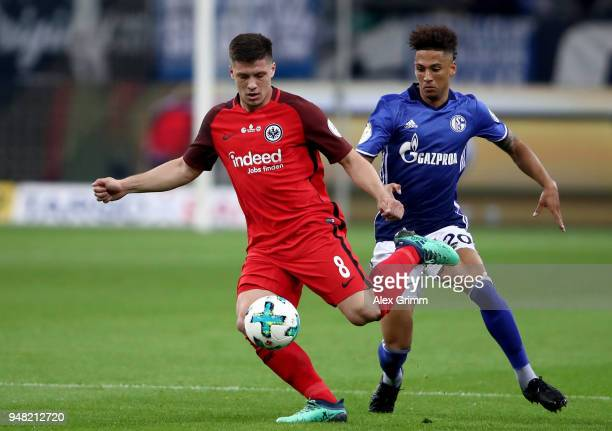 Thilo Kehrer of Schalke and Luka Jovic of Frankfurt battle for the ball during the Bundesliga match between FC Schalke 04 and Eintracht Frankfurt at...