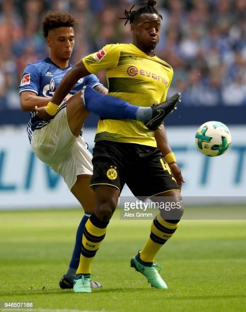 Thilo Kehrer of Schalke and Michy Batshuayi of Dortmund battle for the ball during the Bundesliga match between FC Schalke 04 and Borussia Dortmund...