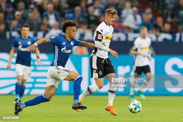 Thilo Kehrer of Schalke and Mickael Cuisance of Moenchengladbach battle for the ball during the Bundesliga match between FC Schalke 04 and Borussia...