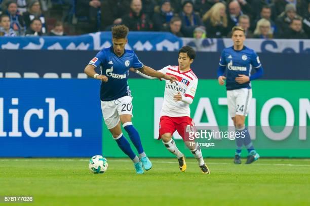 Thilo Kehrer of Schalke and Tatsuya Ito of Hamburg battle for the ball during the Bundesliga match between FC Schalke 04 and Hamburger SV at...