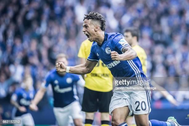 Thilo Kehrer of Schalke celebrates his team's first goal during the Bundesliga match between FC Schalke 04 and Borussia Dortmund at Veltins-Arena on...
