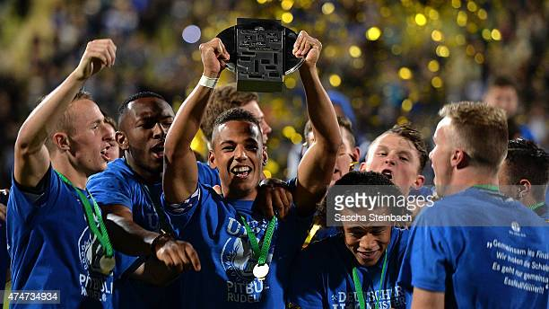 Thilo Kehrer of Schalke celebrates with team mates after winning the U19 A-Juniors Bundesliga final match against 1899 Hoffenheim on May 25, 2015 in...