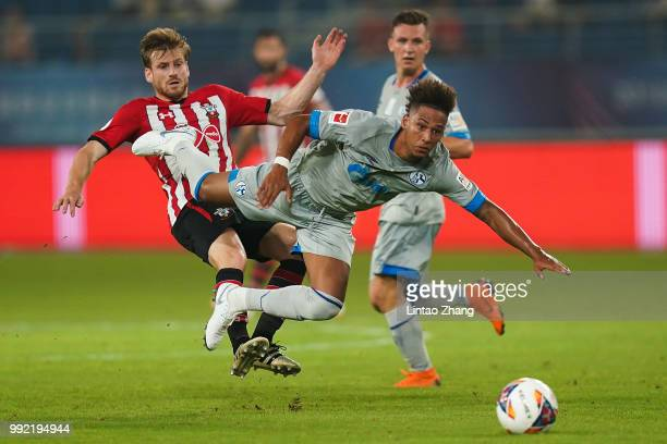 Thilo Kehrer of Schalke FC competes the ball with Stuart Armstrong of Southampton FC during the 2018 Clubs Super Cup match between Schalke and...