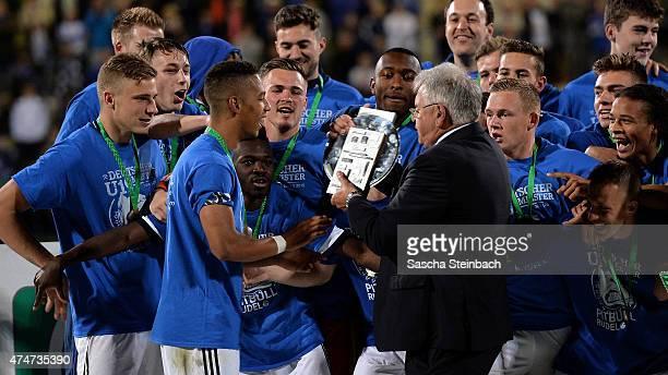 Thilo Kehrer of Schalke gets the trophy after winning the U19 A-Juniors Bundesliga final match against 1899 Hoffenheim on May 25, 2015 in Bochum,...
