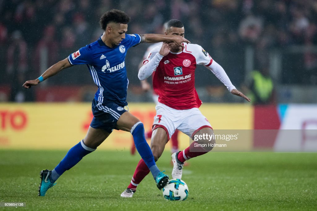 Thilo Kehrer of Schalke is challenged by Robin Quaison of Mainz during the Bundesliga match between 1. FSV Mainz 05 and FC Schalke 04 at Opel Arena on March 9, 2018 in Mainz, Germany.