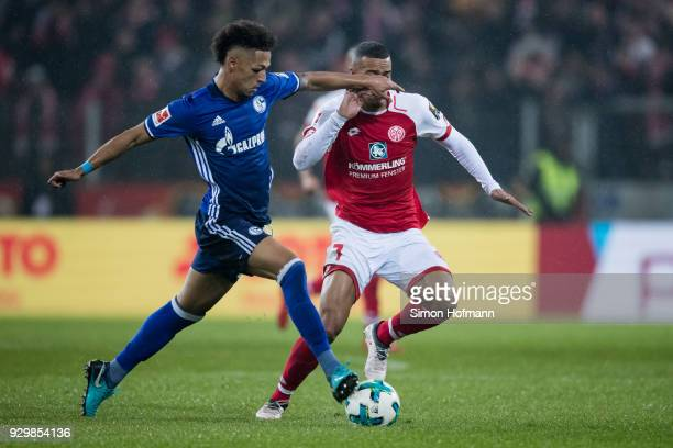 Thilo Kehrer of Schalke is challenged by Robin Quaison of Mainz during the Bundesliga match between 1. FSV Mainz 05 and FC Schalke 04 at Opel Arena...