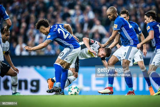 Thilo Kehrer of Schalke Thorgan Hazard of Moenchengladbach Naldo and Leon Goretzka of Schalke in action during the Bundesliga match between FC...