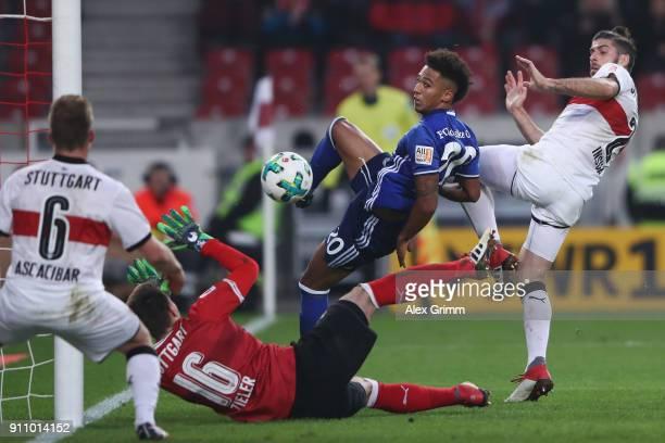 Thilo Kehrer of Schalke tries tro score against goalkeeper RonRobert Zieler Santiago Ascacibar and Emiliano Insua of Stuttgart during the Bundesliga...