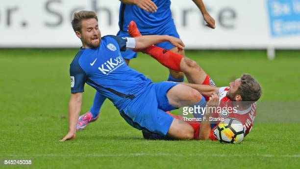 Thilo Leugers of Meppen and Rico Preissinger of Aalen fight for the ball during the 3 Liga match between SV Meppen and VfR Aalen at Haensch Arena on...