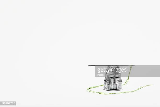 thimble and threaded needle - thimble stock photos and pictures