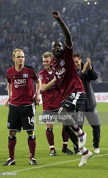 Thimothee Atouba of Hamburg celebrates with his team mates after winning the Bundesliga match between FC Schalke 04 and Hamburger SV at the Veltins...