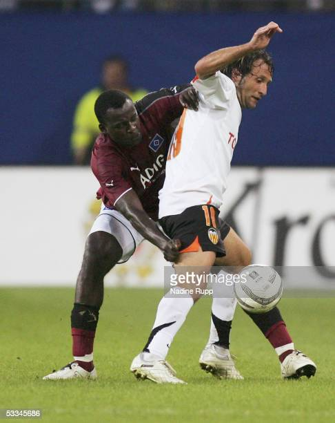 Thimothee Atouba of HSV competes with Rufete of Valencia during the Intertoto Cup Final between Hamburger SV and FC Valencia at the AOL Arena on...