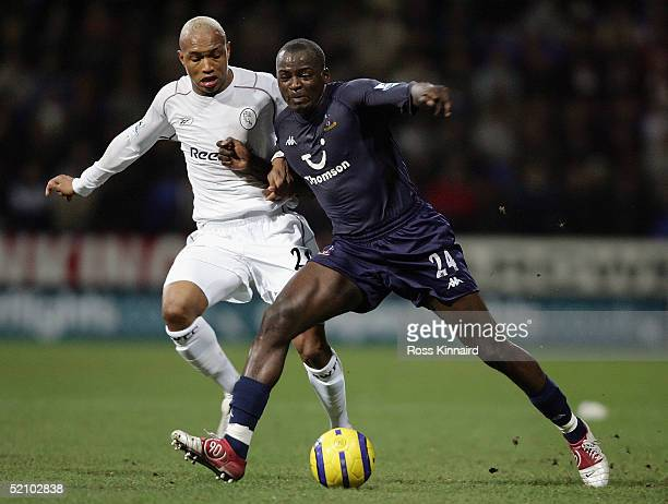 Thimothiee Atouba of Spurs is challenged by ElHadji Diouf of Bolton during the Barclays Premiership match between Bolton Wanderers and Tottenham...