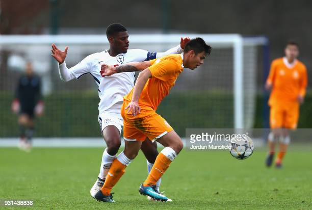 Thimothy Eyoma of Tottenham Hotspur and Santiago Javier Irala Vera of FC Porto in action during the UEFA Youth League group H match between Tottenham...