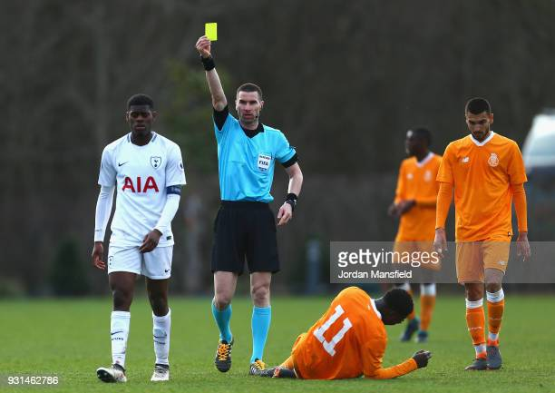 Thimothy Eyoma of Tottenham Hotspur is shown a yellow card during the UEFA Youth League group H match between Tottenham Hotspur and FC Porto at on...