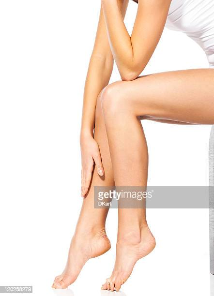 thin and long feet of the beautiful sitting woman - beautiful female feet stock photos and pictures