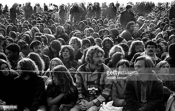 A thin cord separates the crowd of 300000 from the 3 foot high stage and drunken Hells Angels at The Altamont Speedway on December 6 1969 in...