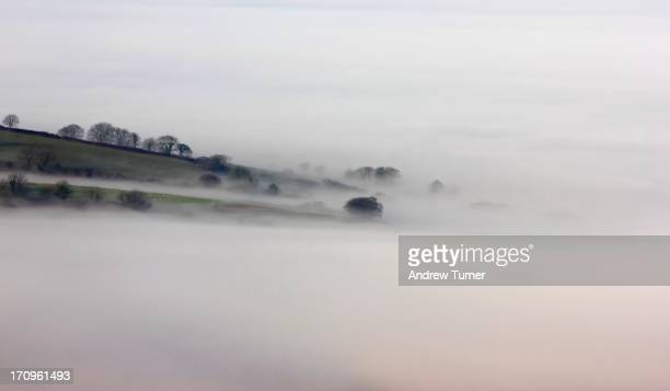 CONTENT] A thin finger of land is all that rises above thick mist in this early morning view from the summit of Brent Tor