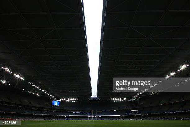 A thin line of light is seen as the roof closes during the round one AFL match between the North Melbourne Kangaroos and the Essendon Bombers at...