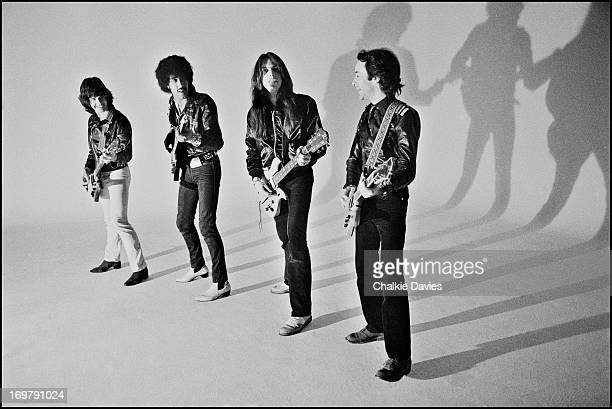 Thin Lizzy pose for a group portrait all playing guitars on the set of the 'Do Anything You Want To Do' music video London 1979 Left to right Gary...