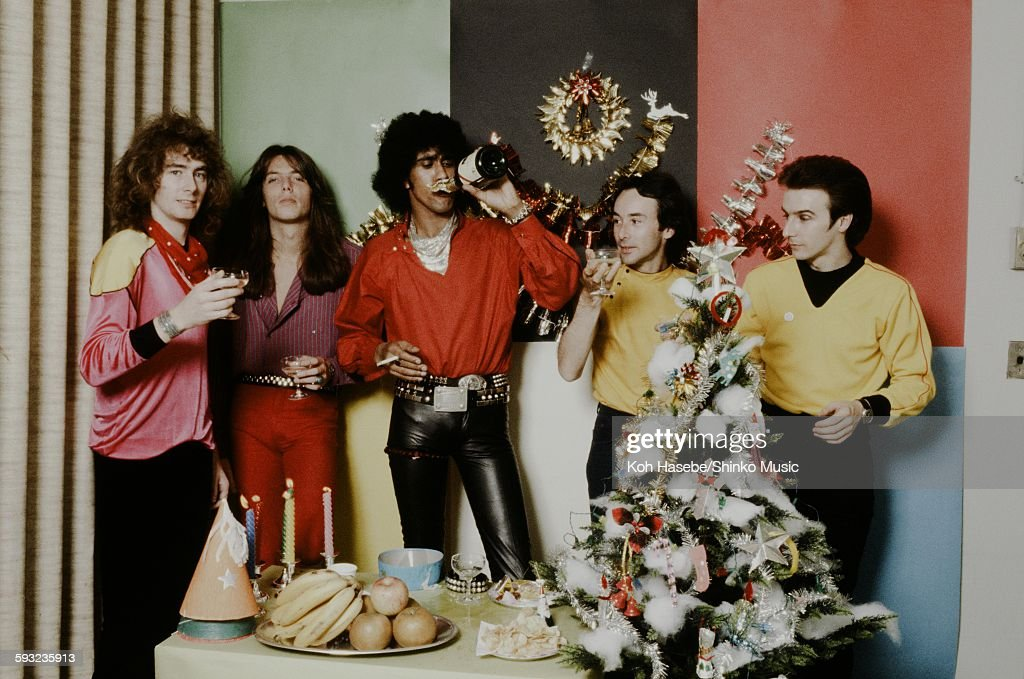 Thin Lizzy taking a photo in the Christmas party scene, Yokohama, September 1980.