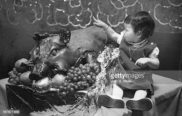 JAN 1971 JAN 27 1971 Things Are 'Porking' Up for New Year Deborah Ann Wong daughter of Dr and Mrs Herbert Wong 3217 W Avondale Drive warily inspects...