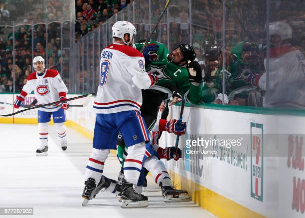 Things get physical between Jordie Benn of the Montreal Canadiens and Jamie Benn of the Dallas Stars at the American Airlines Center on November 21...